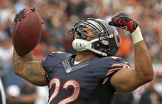 Chicago's Matt Forte celebrates a touchdown run against the Cincinnati Bengals at Soldier Field on September 8, 2013 in Chicago, Illinois. The Bears defeated the Bengals 24-21. (Photo by Jonathan Daniel/Getty Images)